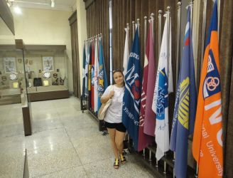 153. MPEI student V. Nifatova with MPEI University flag in HIT museum