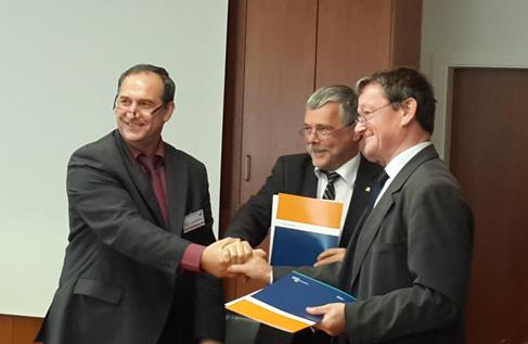 210. Representatives of MPEI, TU Ilmenau and LETI shaking hands after signing the Agreement